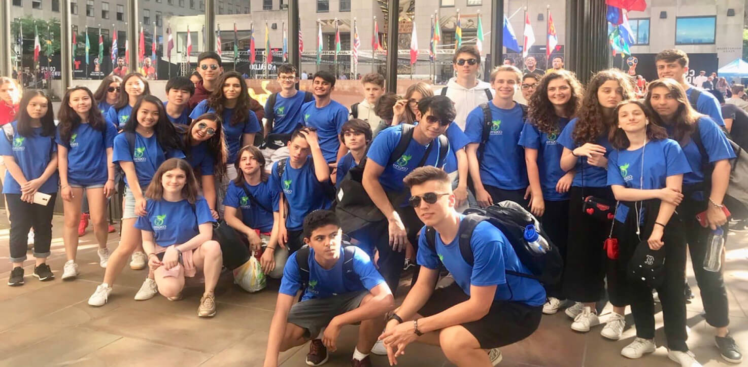 a large group of cogito students, taking part in our SAT summer program, pose for a picture in front of a university library