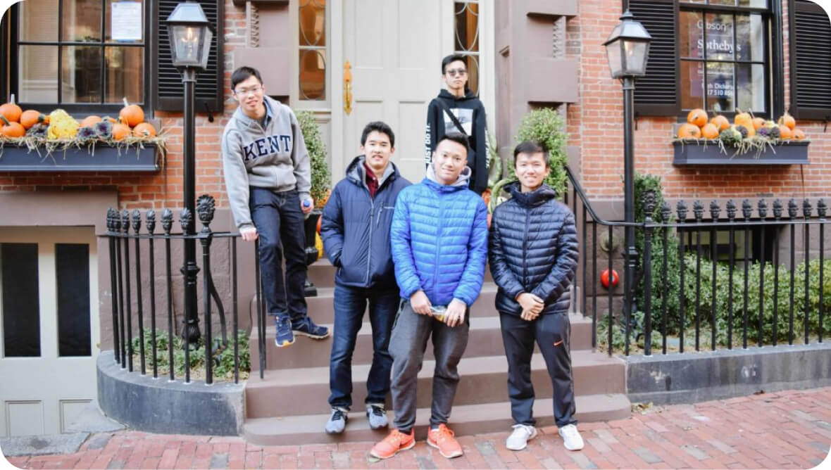 5 young students in outerwear pose for a fun picture in a wealthy neighborhood in our winter school break program in boston